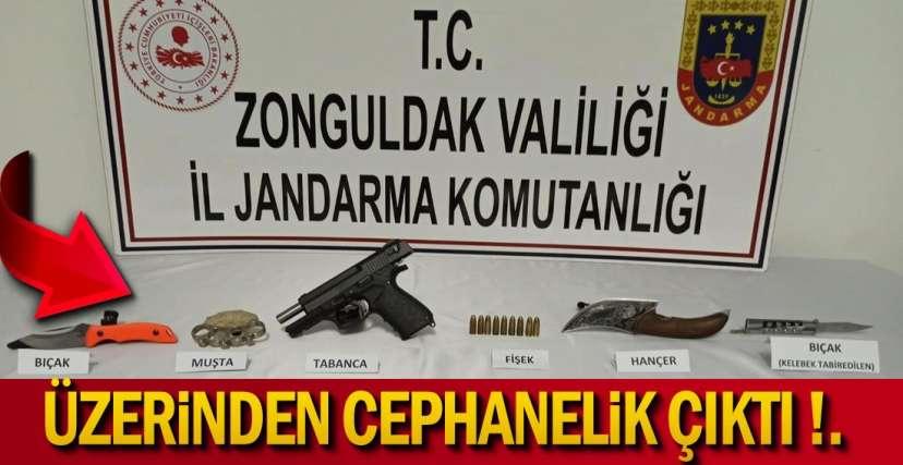 ÜZERİNDEN CEPHANELİK ÇIKTI !.